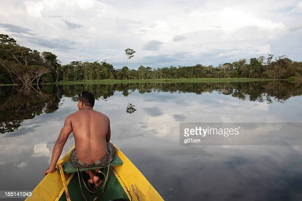 Rear view of a man in a boat going down the Amazon River