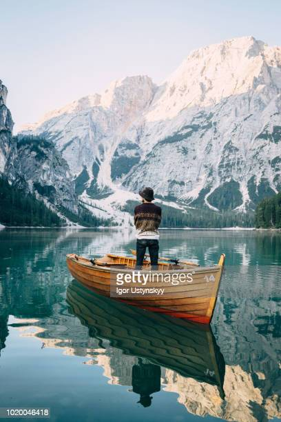 rear view of a man in a rowing boat - rowing boat stock pictures, royalty-free photos & images