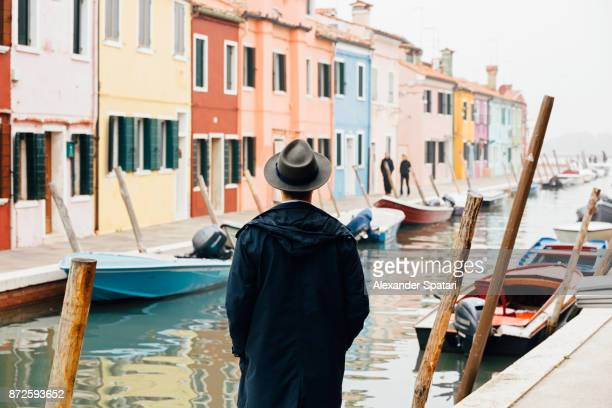 Rear view of a man in Burano, Italy