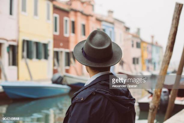 Rear view of a man in hat looking away