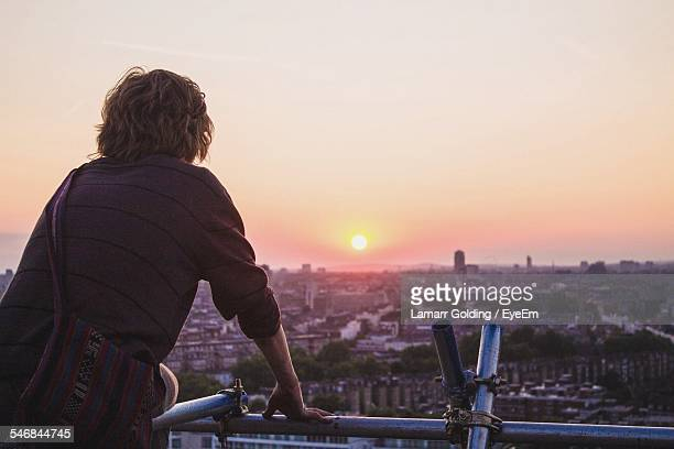rear view of a man overlooking cityscape - look back at early colour photography stock photos and pictures
