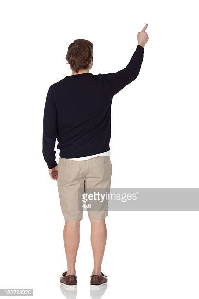 Rear view of a man pointing with finger