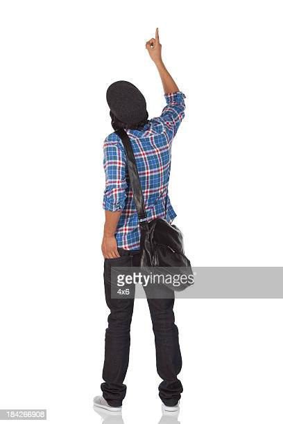rear view of a man pointing with finger - behind stock pictures, royalty-free photos & images