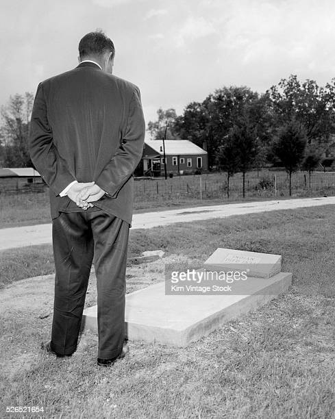 Rear view of a man standing at an anonymous possibly commemorative grave for a Native American from 1833 Possibly marking the beginning of the Trail...
