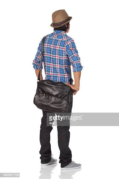 rear view of a man standing - arms akimbo stock pictures, royalty-free photos & images