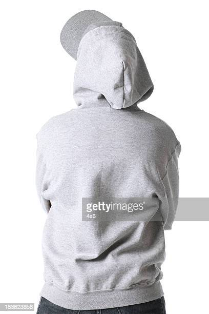 rear view of a man standing with arms crossed - sweatshirt stock pictures, royalty-free photos & images