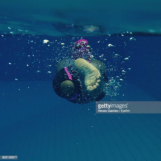 Rear View Of A Man Underwater