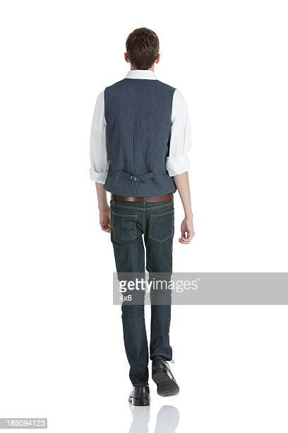 rear view of a man walking - waistcoat stock photos and pictures
