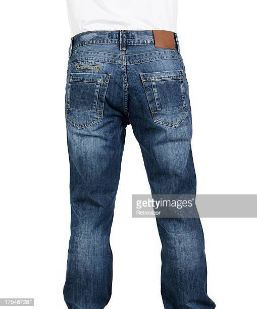 Rear view of a man wearing blue jeans with a blank label