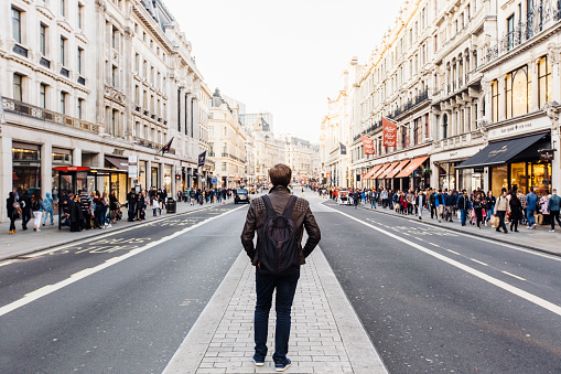 Rear view of a man with backpack exploring street of London, England, UK - gettyimageskorea