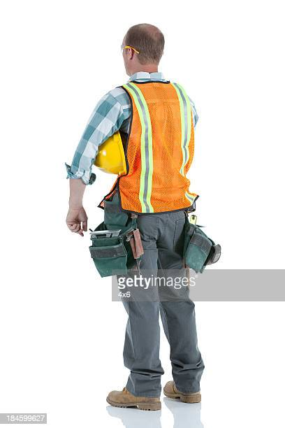 Rear view of a manual worker with hardhat