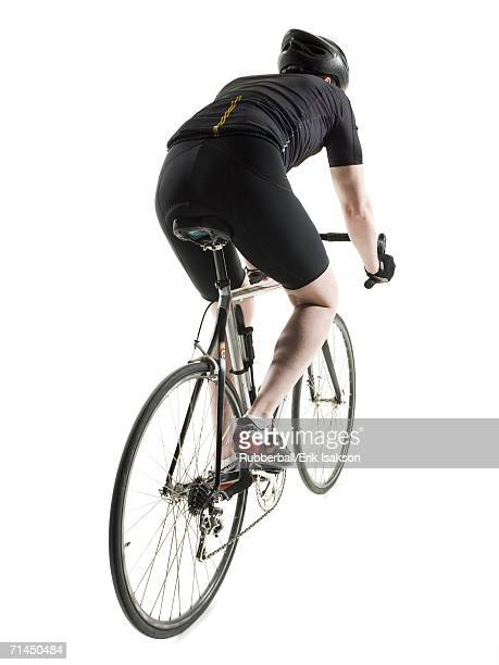 Rear view of a mature man cycling