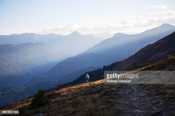 Rear view of a mountain biker riding bike