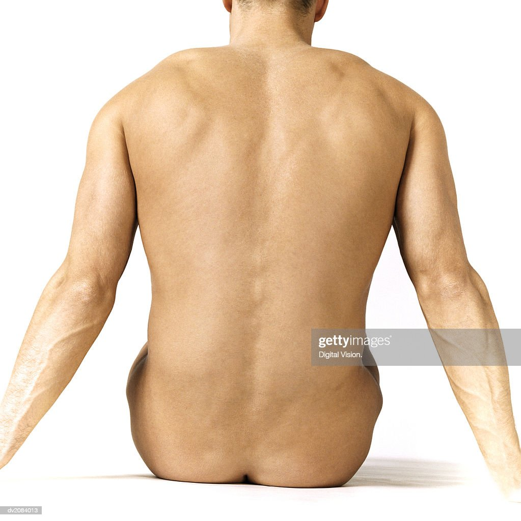 Rear View of a Naked Man Sitting : Stock Photo