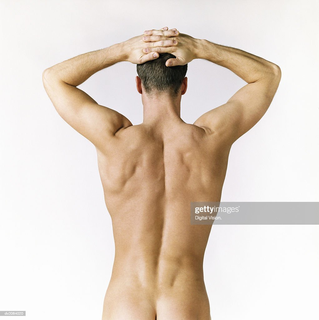 Rear View of a Naked Man With His Arms up : Stock Photo