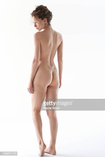 rear view of a naked woman - bare bottom women stock photos and pictures