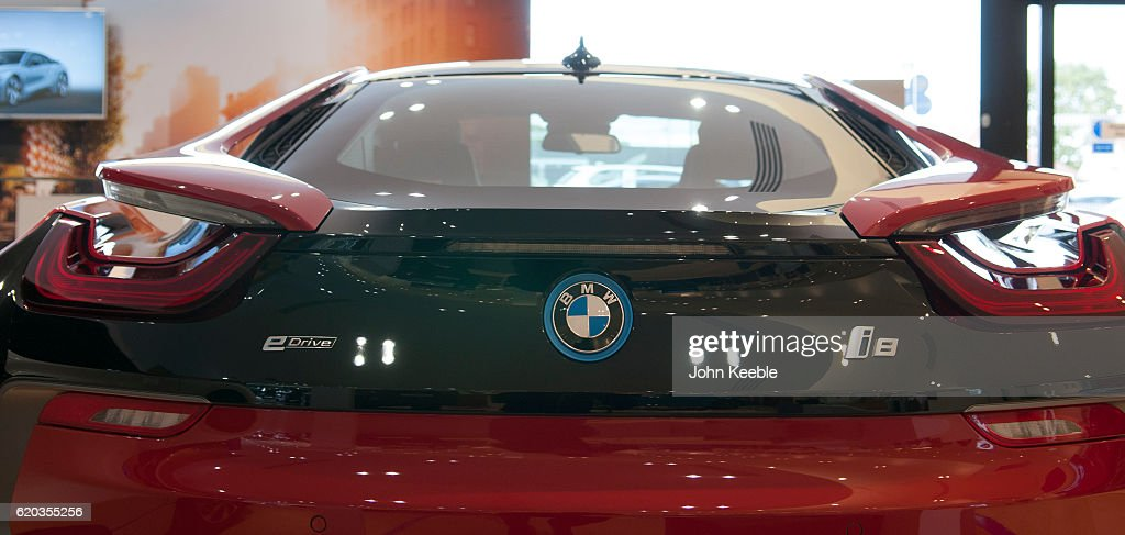 A Rear View Of A New BMW Red And Black BMW I8 Edrive Hybrid Car On