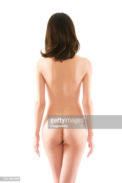 Rear view of a nude young woman against white background