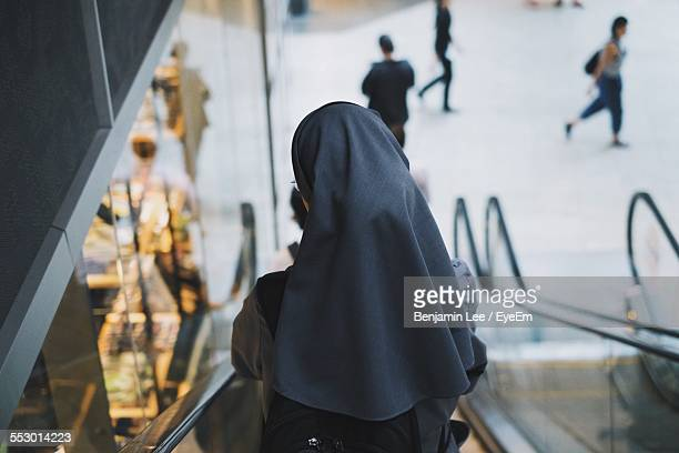 rear view of a nun on escalator - nun stock pictures, royalty-free photos & images
