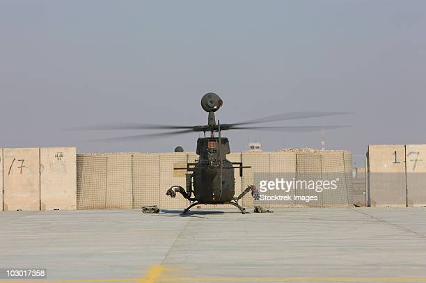 Rear view of a OH-58D Kiowa Warrior parked on the flight line at Camp Speicher, Iraq.