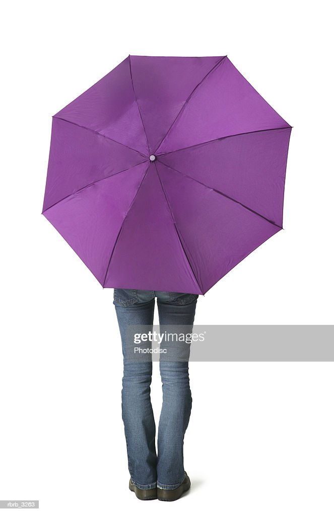 Rear view of a person holding an umbrella : Foto de stock