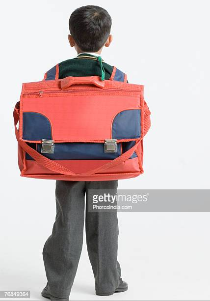 Rear view of a schoolboy carrying a schoolbag