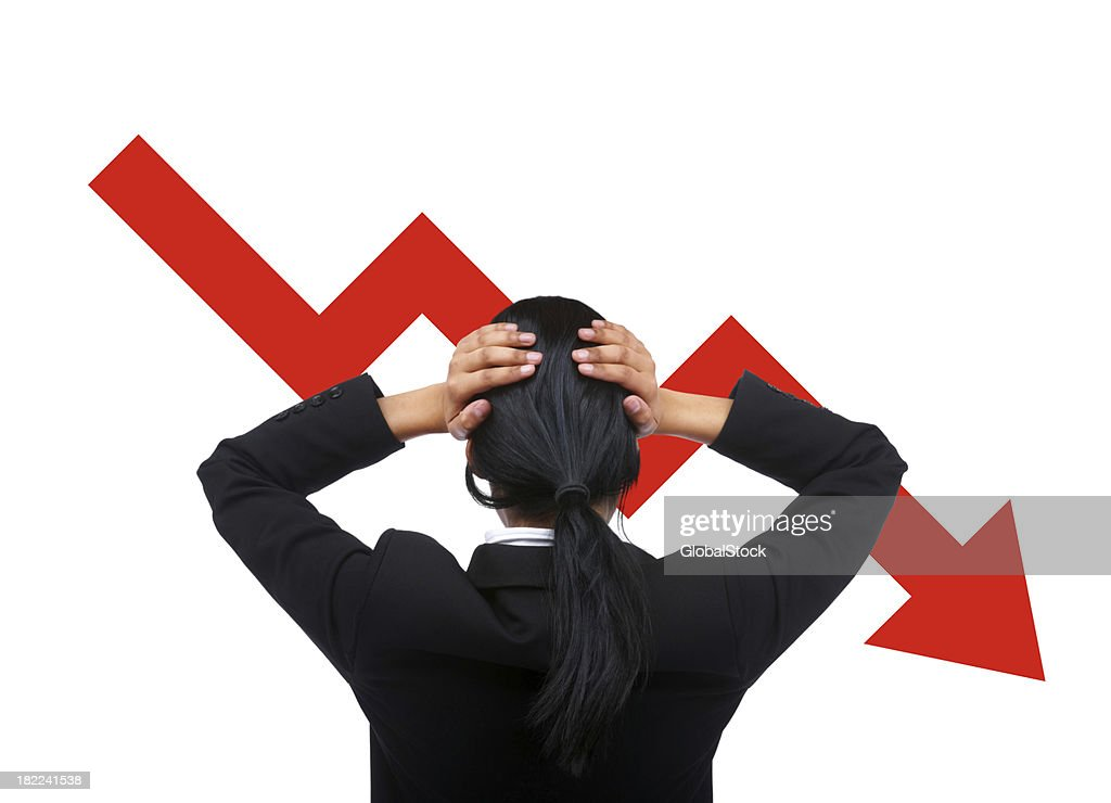 Rear view of a tensed business woman : Stock Photo