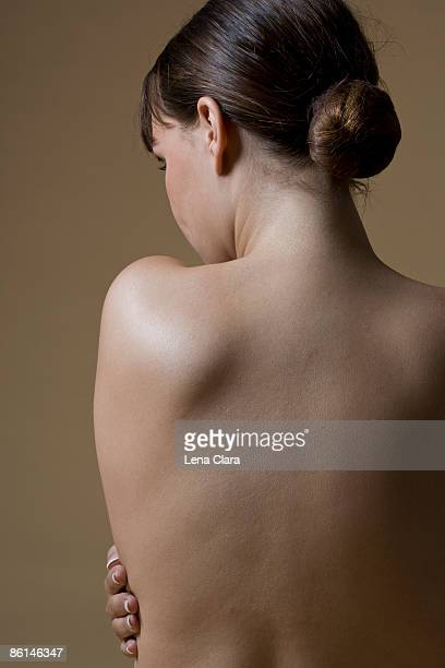 Rear view of a topless woman
