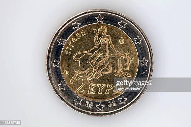 Rear view of a two Euro coin with image of Europa riding a bull