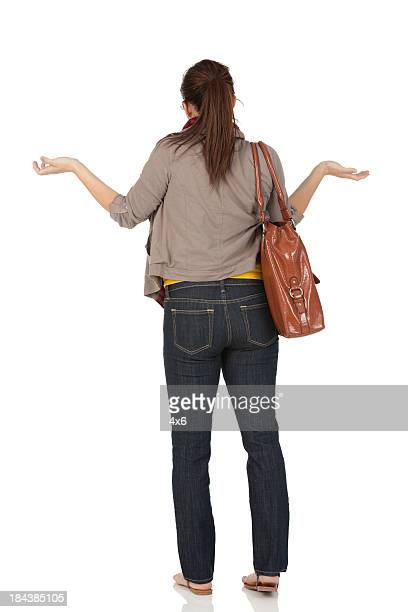 Rear view of a woman gesturing