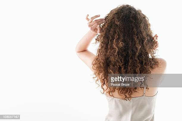 rear view of a woman - curly stock pictures, royalty-free photos & images