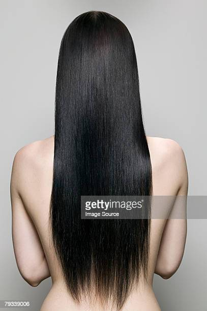 rear view of a woman - long hair stock pictures, royalty-free photos & images