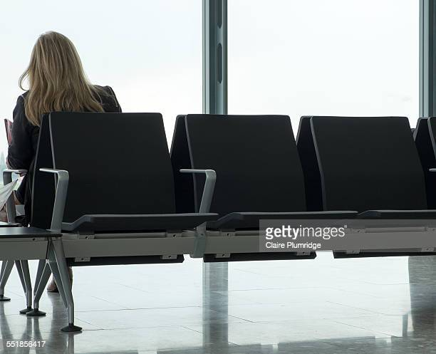 rear view of a woman sitting - claire plumridge stock pictures, royalty-free photos & images