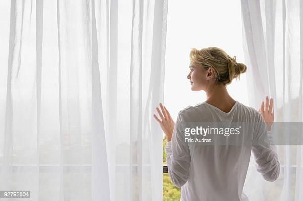 rear view of a woman standing on balcony - look back at early colour photography stock pictures, royalty-free photos & images