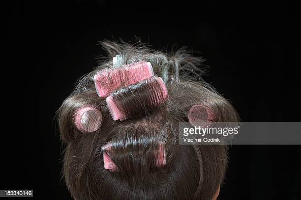 Rear view of a woman with curlers in her hair