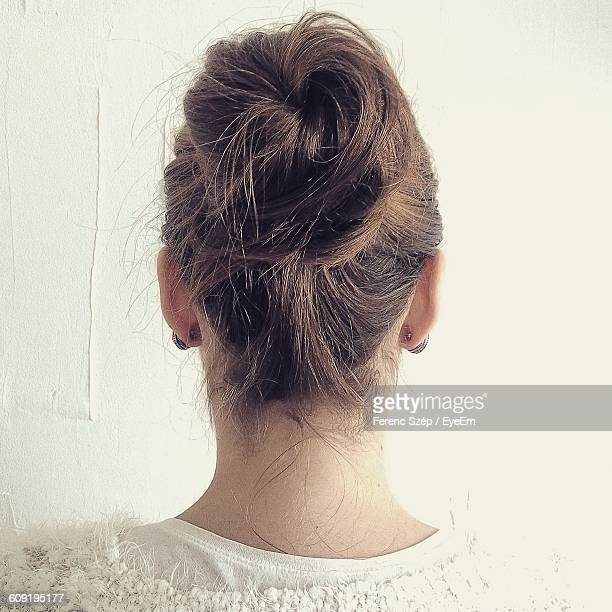 Rear View Of A Woman With Hair Bun