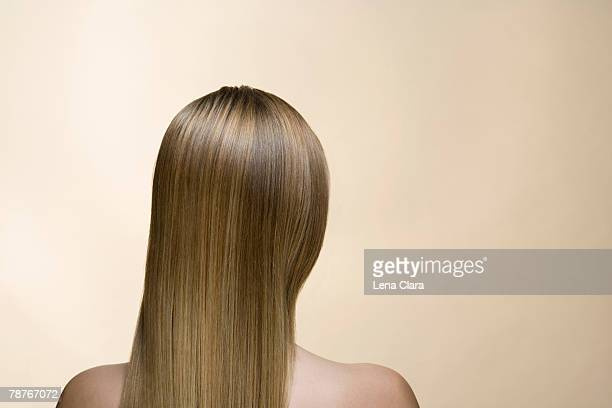 Rear view of a woman with long blond hair