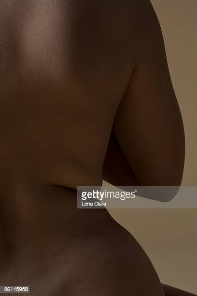 rear view of a woman's back - curve stock pictures, royalty-free photos & images