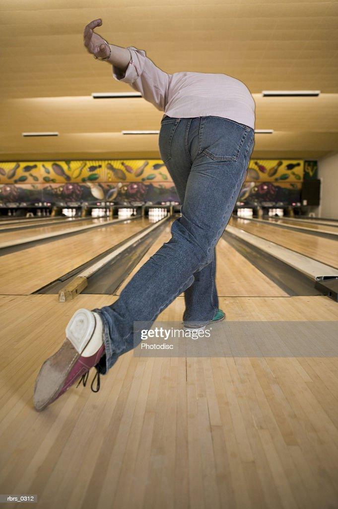Rear view of a young man bowling : Foto de stock