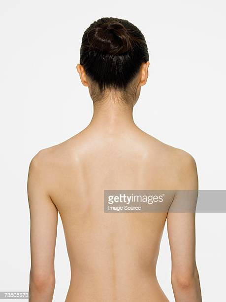 rear view of a young woman - naket bildbanksfoton och bilder