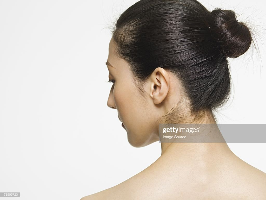 Rear view of a young woman : Stock Photo