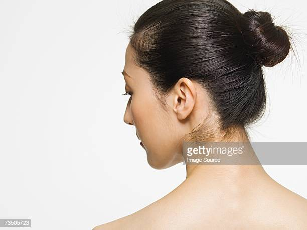 rear view of a young woman - hair bun stock pictures, royalty-free photos & images