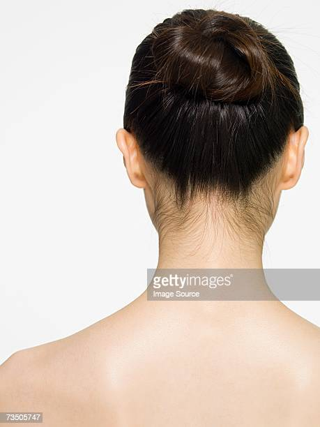 rear view of a young woman - up do stock pictures, royalty-free photos & images