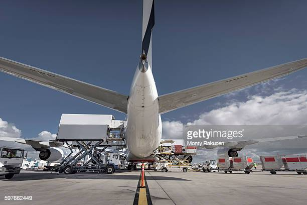 Rear view of A380 jet aircraft being loaded at airport