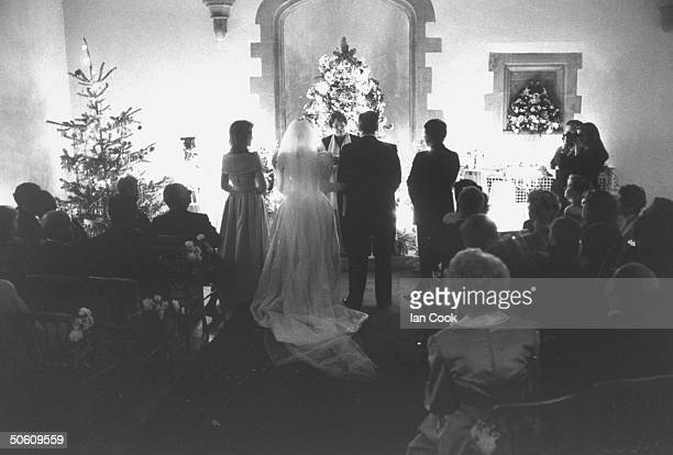 Rear view of actress Deidre Hall wearing gorgeous wedding dress designed by Nolan Miller w TV producer Steven Sohmer w his best man sister/matron of...