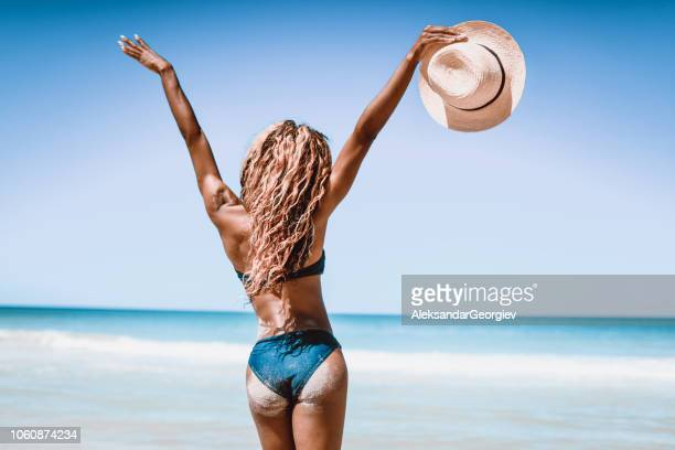 rear view of african american female with arms raised on the cuban beach - black sexual stock photos and pictures