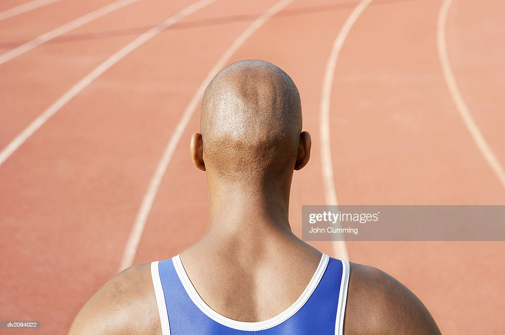 Rear View of an Athlete on a Running Track : Stock Photo