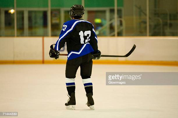 Rear view of an ice hockey player playing ice hockey