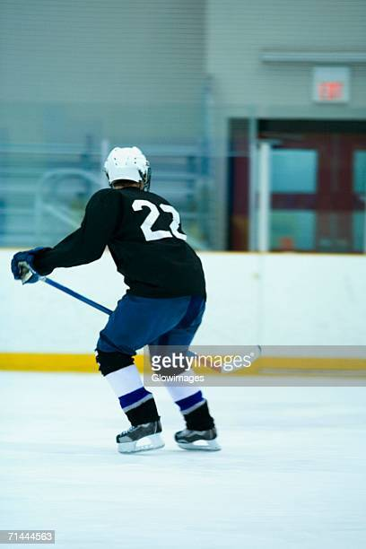 rear view of an ice hockey player playing ice hockey - ice hockey glove stock pictures, royalty-free photos & images