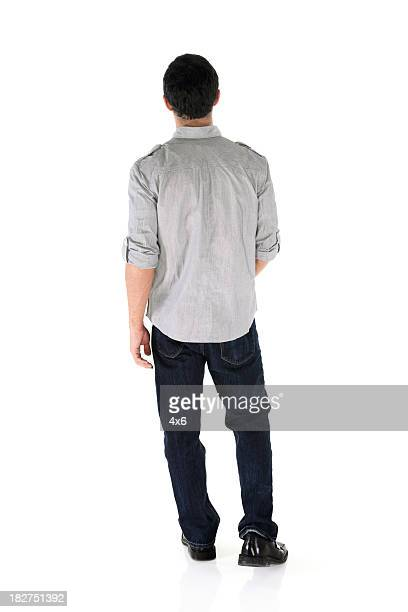 Rear view of an isolated casual male